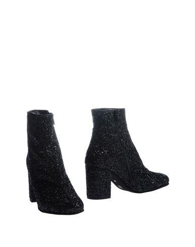Полусапоги и высокие ботинки от ANGELA RIPARI