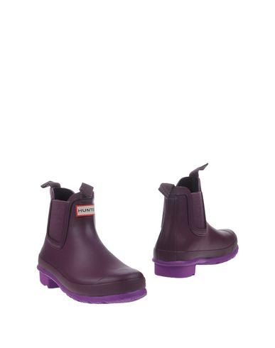 Полусапоги и высокие ботинки HUNTER