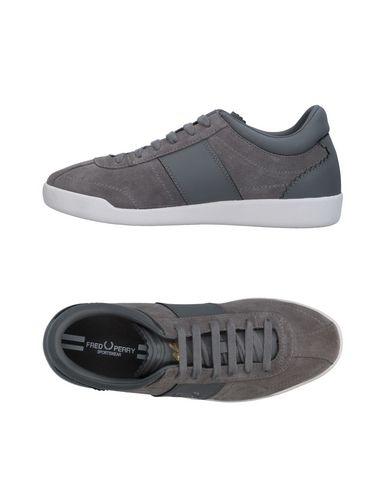 Фото - Низкие кеды и кроссовки светло-серого цвета