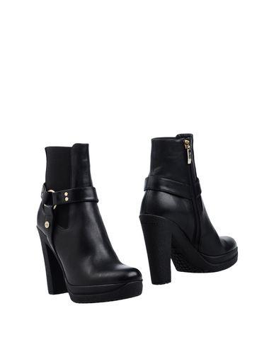 Полусапоги и высокие ботинки от CESARE PACIOTTI 4US