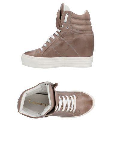 Фото - Высокие кеды и кроссовки от LEMARÉ цвета хаки