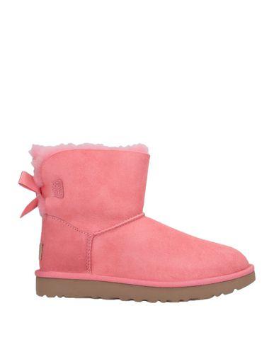 Фото - Полусапоги и высокие ботинки розового цвета