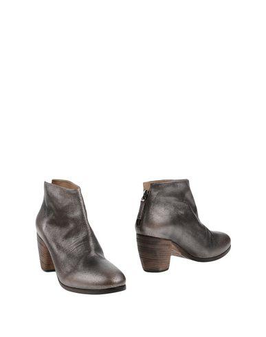 Полусапоги и высокие ботинки от SETTIMA