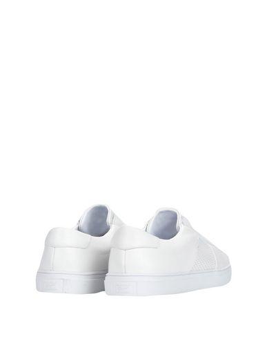 Фото 2 - Низкие кеды и кроссовки от ONITSUKA TIGER белого цвета