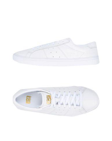 Фото - Низкие кеды и кроссовки от ONITSUKA TIGER белого цвета