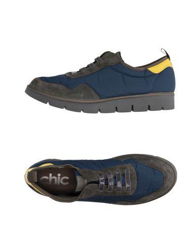 Фото - Низкие кеды и кроссовки от PÀNCHIC темно-синего цвета