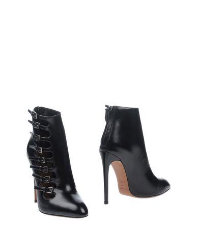 Полусапоги и высокие ботинки от ALAÏA