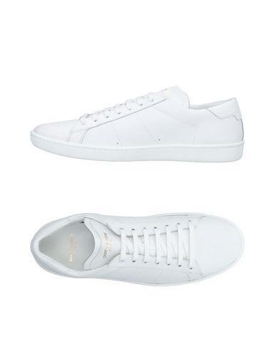 Фото - Низкие кеды и кроссовки белого цвета