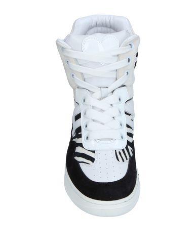 Фото 2 - Высокие кеды и кроссовки белого цвета
