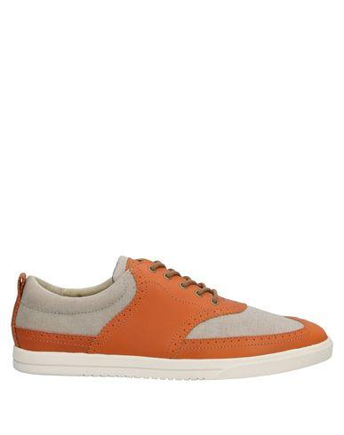Фото - Низкие кеды и кроссовки от CLAE желто-коричневого цвета