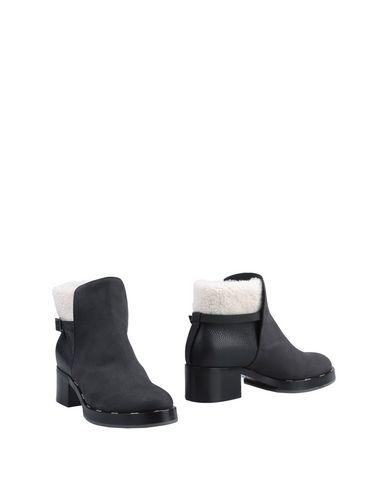 zapatillas POLLINI Botines de ca?a alta mujer