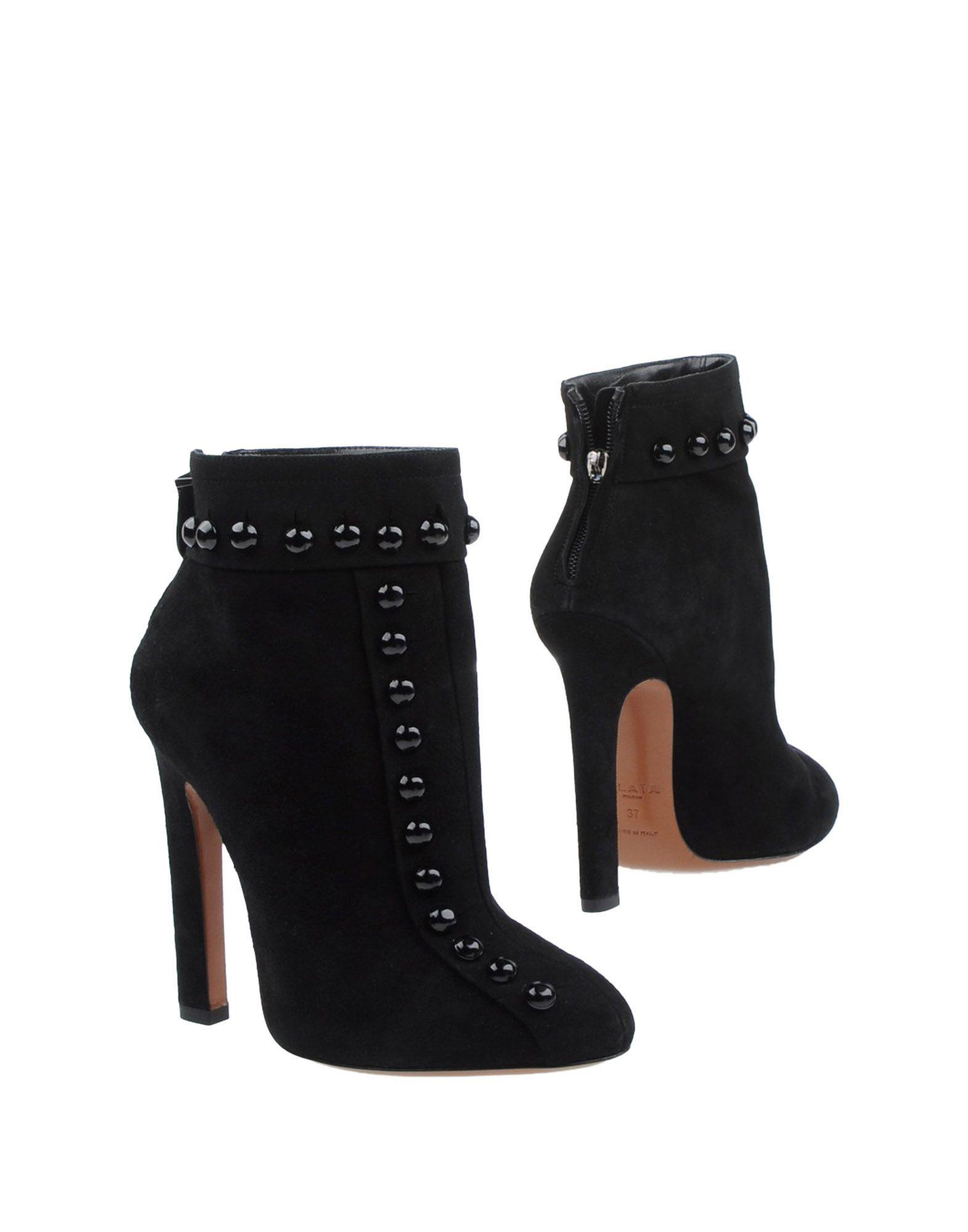 Фото ALAÏA Полусапоги и высокие ботинки. Купить с доставкой