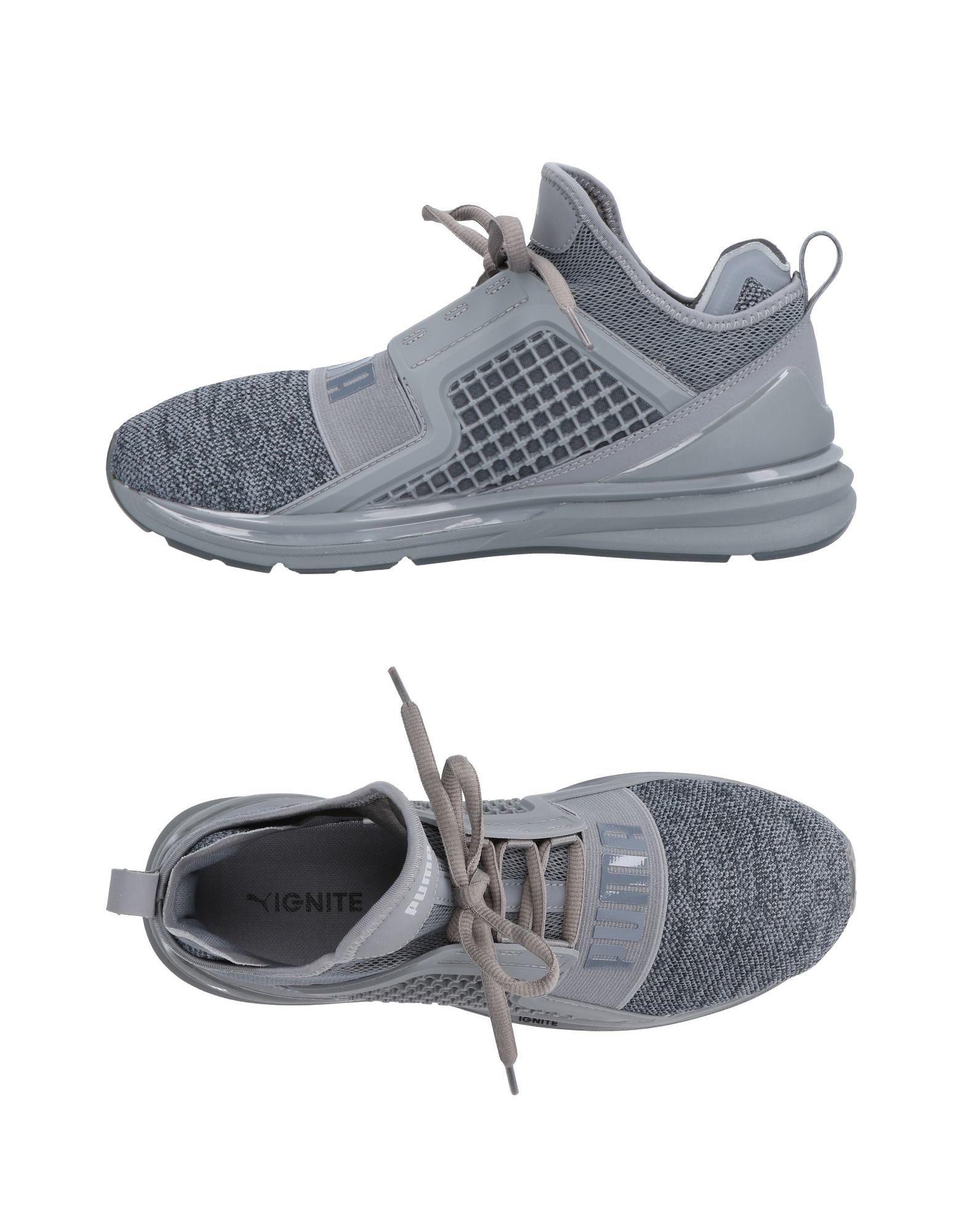 PUMA Низкие кеды и кроссовки