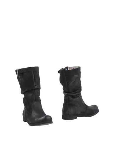 Фото - Полусапоги и высокие ботинки от CRISTIAN G черного цвета