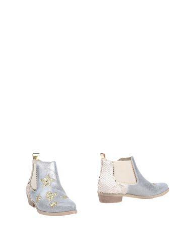 Фото - Полусапоги и высокие ботинки от DIVINE FOLLIE серебристого цвета