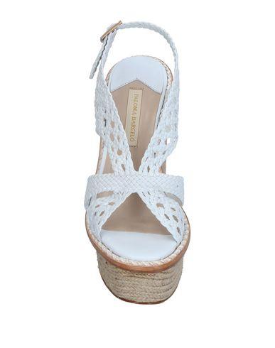 Фото 2 - Женские сандали PALOMA BARCELÓ белого цвета