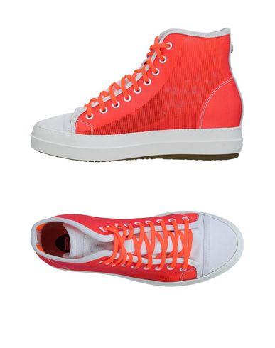 Фото - Высокие кеды и кроссовки от RUCO LINE кораллового цвета