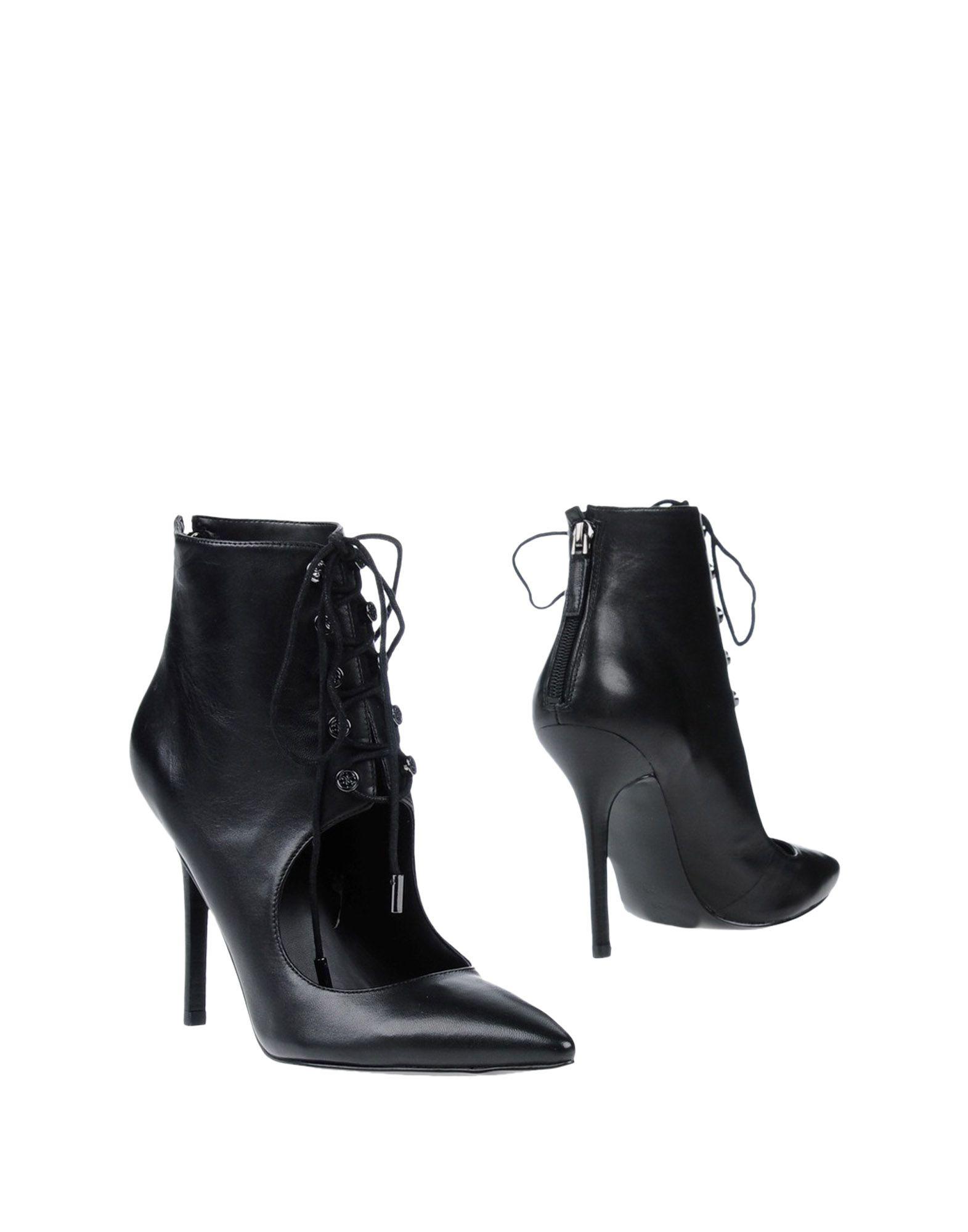 Фото GUESS Полусапоги и высокие ботинки. Купить с доставкой