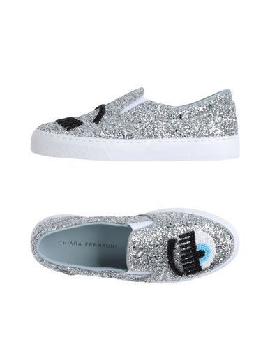 Купить Низкие кеды и кроссовки от CHIARA FERRAGNI серебристого цвета