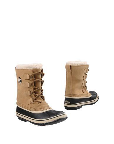 Купить Полусапоги и высокие ботинки бежевого цвета