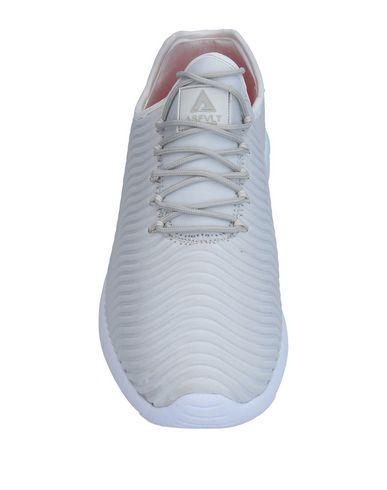 Фото 2 - Низкие кеды и кроссовки от ASFVLT светло-серого цвета