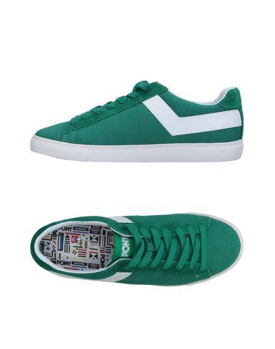 Купить Низкие кеды и кроссовки зеленого цвета