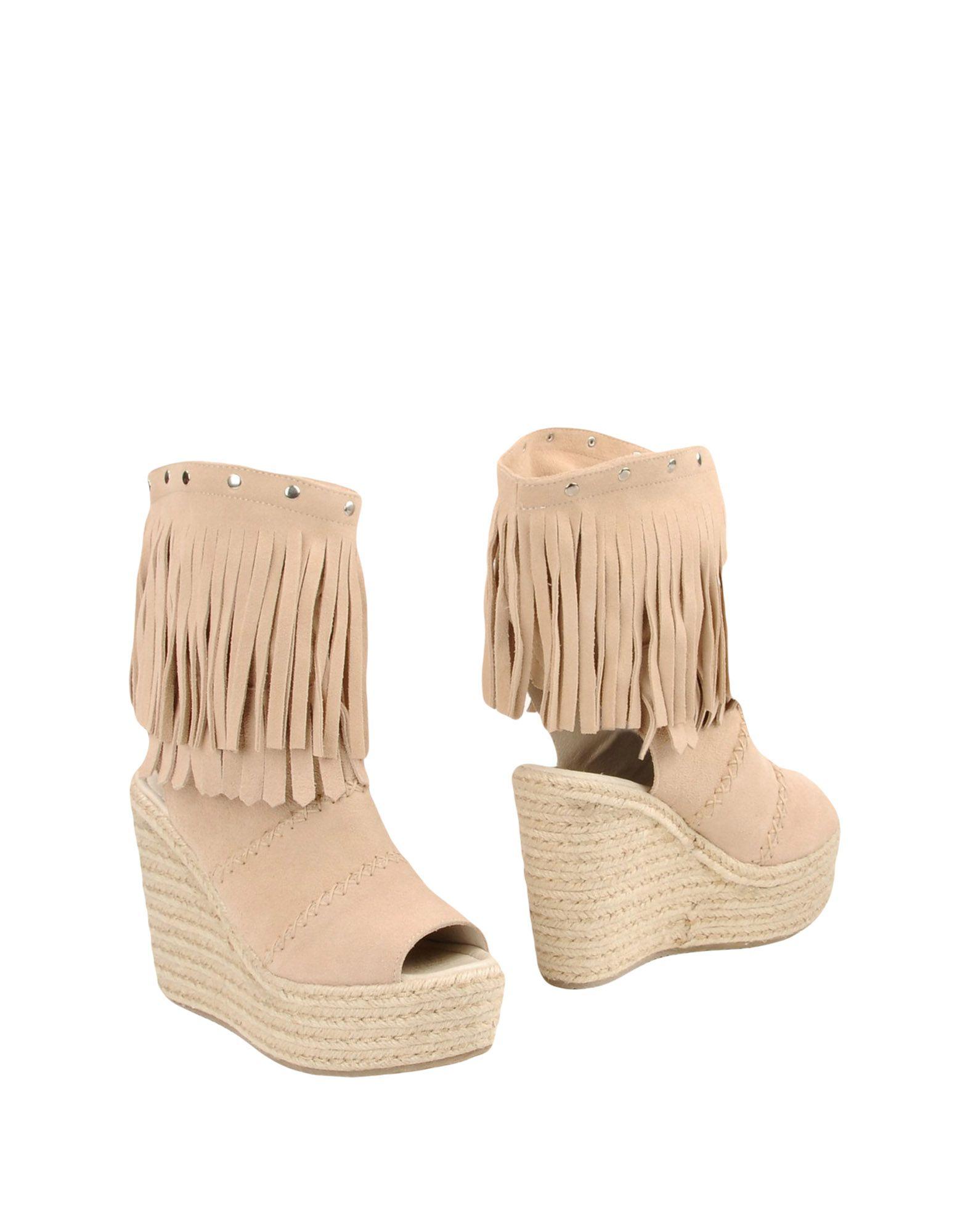 купить SPAZIOMODA Полусапоги и высокие ботинки дешево