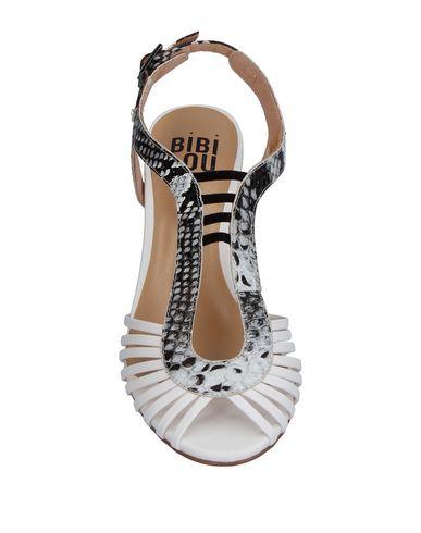 Фото 2 - Женские сандали BIBI LOU белого цвета