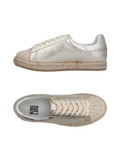 Фото - Низкие кеды и кроссовки от BIBI LOU золотистого цвета