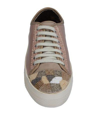Фото 2 - Низкие кеды и кроссовки от BIBI LOU пастельно-розового цвета