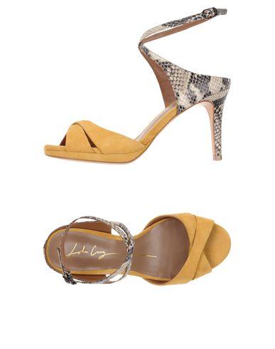Фото - Женские сандали  золотистого цвета