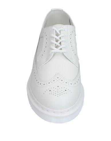 Фото 2 - Обувь на шнурках белого цвета