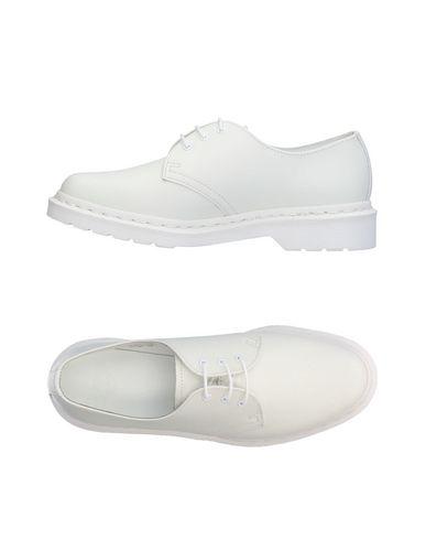 Фото - Обувь на шнурках белого цвета
