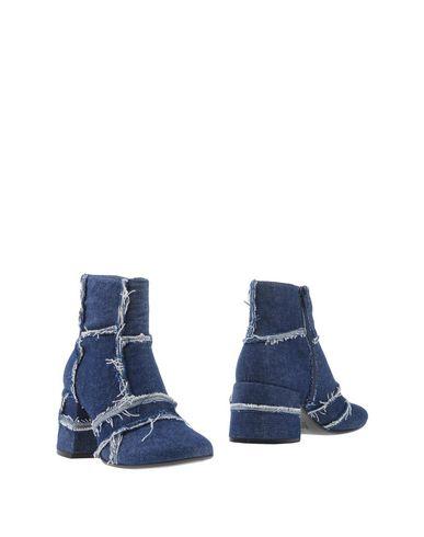 Купить Полусапоги и высокие ботинки синего цвета