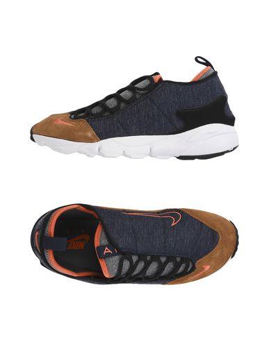 Imagen principal de producto de NIKE AIR FOOTSCAPE NM - CALZADO - Sneakers & Deportivas - Nike