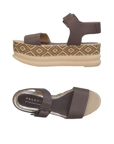 Фото - Женские сандали  серого цвета
