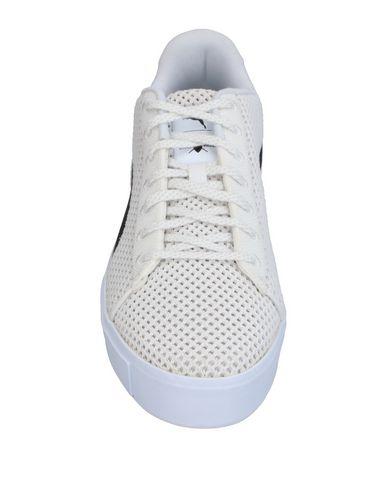 Фото 2 - Низкие кеды и кроссовки от PUMA X DAILY PAPER белого цвета