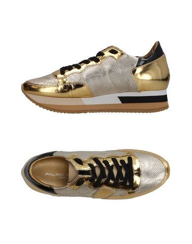 Фото - Низкие кеды и кроссовки от PHILIPPE MODEL золотистого цвета