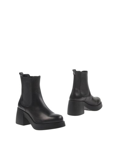 Фото - Полусапоги и высокие ботинки от CULT черного цвета