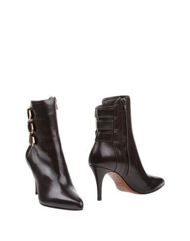 Фото - Полусапоги и высокие ботинки от KALLISTÈ темно-коричневого цвета