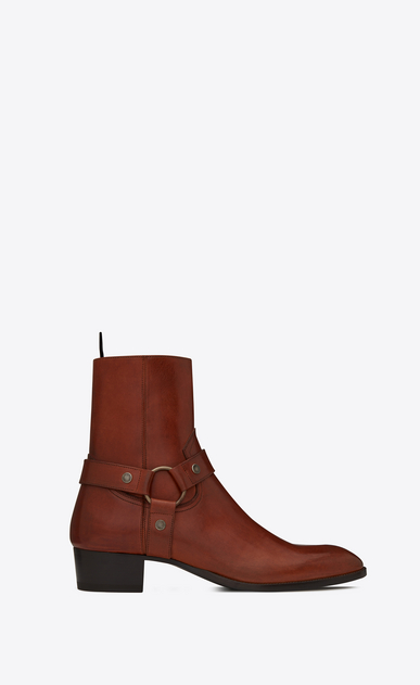SAINT LAURENT Boots Man WYATT 40 harness boots in caramel leather a_V4