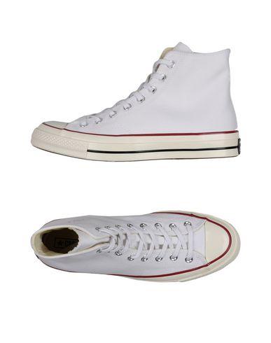 Фото - Высокие кеды и кроссовки от CONVERSE ALL STAR белого цвета