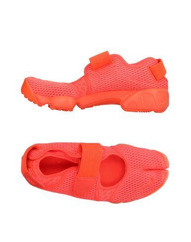 Фото - Низкие кеды и кроссовки оранжевого цвета