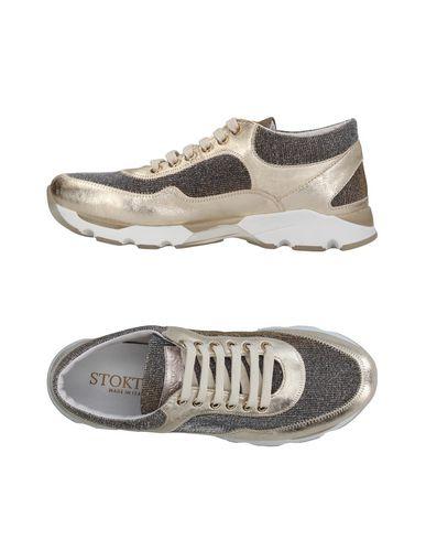 Фото - Низкие кеды и кроссовки от STOKTON золотистого цвета