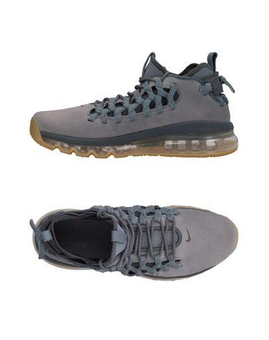 Фото - Низкие кеды и кроссовки серого цвета