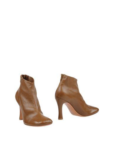 Купить Полусапоги и высокие ботинки от CÉLINE цвета хаки