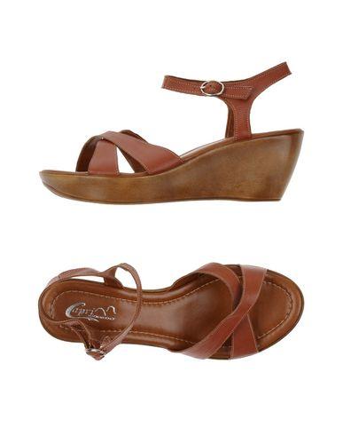 Фото - Женские сандали  коричневого цвета