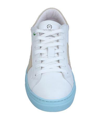 Фото 2 - Низкие кеды и кроссовки от WOMSH белого цвета