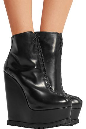 ALAÏA Leather wedge ankle boots