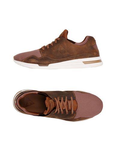 Фото - Низкие кеды и кроссовки коричневого цвета